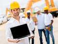 Construction worker with a computer male laptop Royalty Free Stock Photo