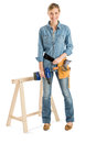 Construction worker with drill and belt standing by work horse full length portrait of happy young female tool against white Royalty Free Stock Images