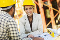 Construction worker and female architect Royalty Free Stock Photo