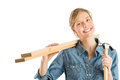 Construction worker with hammer carrying wooden planks on should portrait of young female shoulder against white background Stock Photos