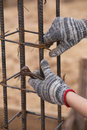 Construction worker hands working with pincers on fixin Royalty Free Stock Photo