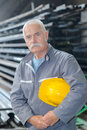 Construction worker with helmets at work place in factory Royalty Free Stock Photo