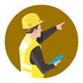 Construction worker holding a clipboard pointing at something