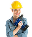 Construction worker holding cordless drill while looking away beautiful young isolated over white background Stock Image