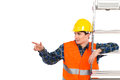 Construction worker with ladder pointing at copy space in yellow helmet and orange waistcoat looking waist up studio shot isolated Stock Images