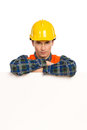 Construction worker lean on banner smiling in yellow helmet with crossed arms white close up studio shot isolated white Stock Photography