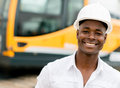 Construction worker with machines at the background looking happy Stock Photography