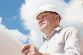 A construction worker man in white helmet holding Royalty Free Stock Photo