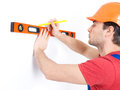 Construction worker measuring level wall over white background manual worker images Stock Photography