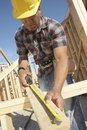 Construction Worker Measuring Timber Royalty Free Stock Photo