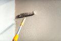 Construction worker painting walls using paint roller. Royalty Free Stock Photo