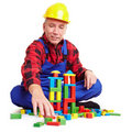 Construction worker playing Royalty Free Stock Image