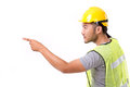 Construction worker pointing sideway to blank space Stock Photo