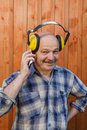 Construction worker in protective headphones during a break talk Royalty Free Stock Photo