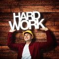Construction worker red shirt yellow hardhat hard work concept Royalty Free Stock Image