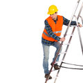 Construction worker in reflective clothing climbing a ladder yellow helmet and orange waistcoat full length studio shot isolated Stock Images