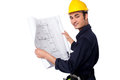 Construction worker reviewing blueprint professional with hard hat is holding plan Royalty Free Stock Image