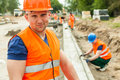 Construction worker in safety waistcoat orange and helmet Royalty Free Stock Image