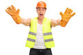 Construction worker shouting and gesturing studio shot of a isolated on white background Royalty Free Stock Images
