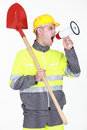 Construction worker with shovel shouting into megaphone Stock Photos