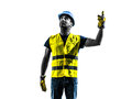 Construction worker signaling looking up hoist silhouette one isolated in white background Royalty Free Stock Image