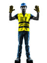 Construction worker signaling stop gesture silhoue one with safety vest silhouette isolated in white background Stock Photography
