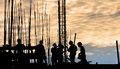 Construction worker silhouette on the work place Royalty Free Stock Photo
