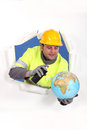 Construction worker with spray and globe Royalty Free Stock Photography