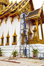 Construction worker are standing on bangkok thailand december the scaffold for renovating the temple dusit maha prasat in the Stock Photo