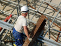 Construction worker with steel beam Stock Photos