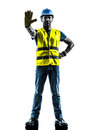 Construction worker stop gesture safety vest silhouette one with isolated in white background Stock Image