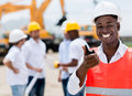 Construction worker talking on a radio and looking happy Stock Photo