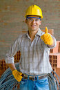 Construction worker with thumbs up Stock Photo