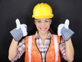 Construction worker thumbs up happy woman portrait doing with protection wear young wearing safety glasses vest and yellow hard Stock Photo