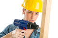 Construction worker using cordless drill on wooden plank close up of young female against white background Stock Image