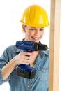Construction worker using cordless drill on wooden plank happy female against white background Royalty Free Stock Photo