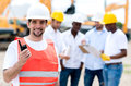 Construction worker with a walkie talkie at building site Stock Photo