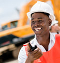 Construction worker with a walkie talkie looking very happy Royalty Free Stock Images