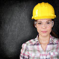 Construction worker woman on blackboard texture serious home owner in renovations or engineer face black background with Royalty Free Stock Photos