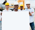 Construction workers with a banner group of holding white Stock Photography