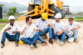 Construction workers on a break group of at building site Stock Image