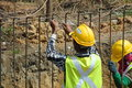 Construction workers fabricate retaining wall reinforcement bar at the construction site selangor malaysia – february Stock Photos