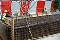 Construction workers fabricate retaining wall reinforcement bar at the construction site selangor malaysia – february Royalty Free Stock Photography