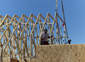Construction Workers installiing Roof Truss Royalty Free Stock Photo