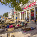 Construction workers relax at Connaught place