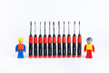Construction workers with set of screwdriver Royalty Free Stock Photo