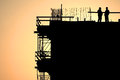 Construction workers silhouettes at sunset Royalty Free Stock Photo
