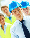 Construction workers standing together Stock Image