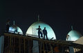 Construction workers working in the middle of the night in deira, dubai, uae Royalty Free Stock Photo