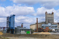 Constructions granary and elevator with cloudy sky Royalty Free Stock Image